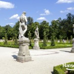 WARSAW, POLAND - AUGUST 20, 2014: Garden Sculptures in the Wilanow park created in the 2nd half of the 17th century together with the Royal Palace built for King Jan III Sobieski